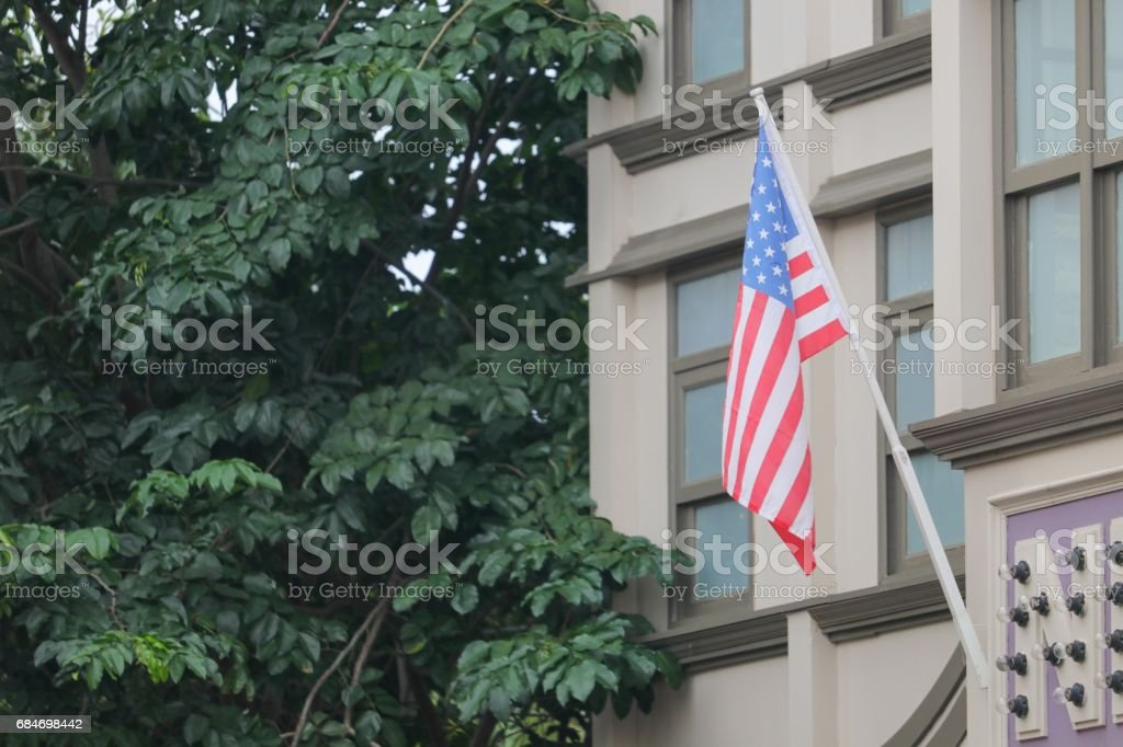 American flag on building stock photo