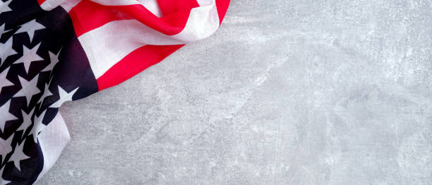 American flag on concrete stone background with copy space. Banner template for USA Memorial day, Presidents day, Veterans day, Labor day, or 4th of July celebration.