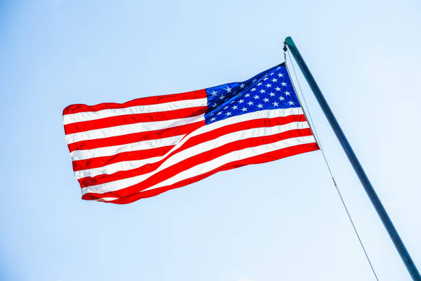 American flag on flagpole stock photo