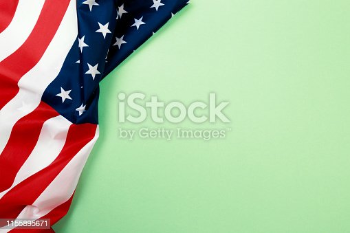 istock American flag on green  background  top view - Image 1155895671