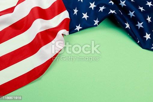istock American flag on green  background  top view - Image 1156871915