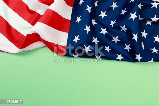istock American flag on green  background  top view - Image 1157083617