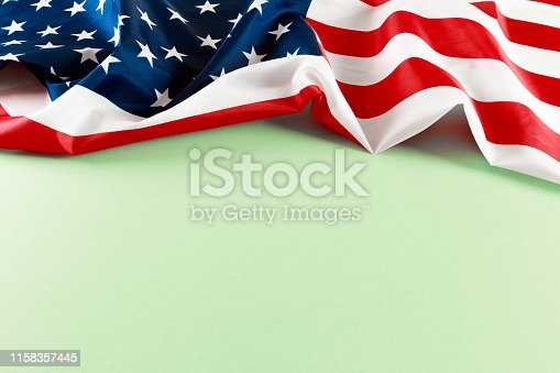 istock American flag on green  background  top view - Image 1158357445
