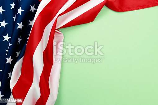 istock American flag on green  background  top view - Image 1158558498