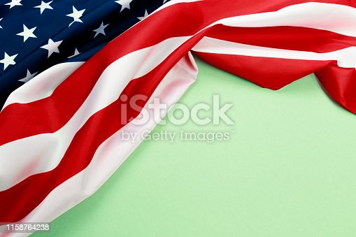 istock American flag on green  background  top view - Image 1158764238