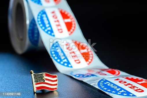 1157022917 istock photo American flag on I voted today stickers, patriotic motive during the elections of the American president. 1140591146