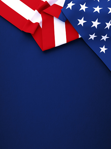 American flag on navy blue background. Vertical composition with copy space. Directly above.