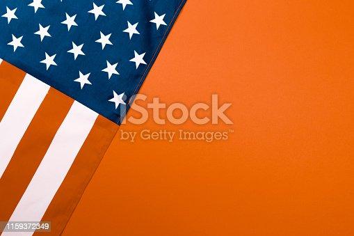 istock American flag on orange  background  top view - Image 1159372349