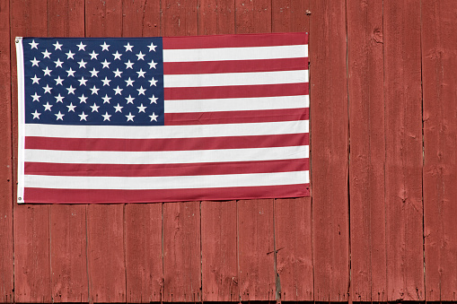 What could be more patriotic than an American Flag on barn siding?