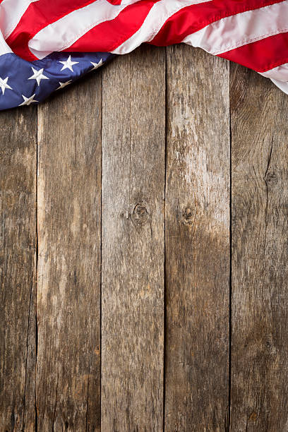 American Flag On Rustic Wooden Background stock photo