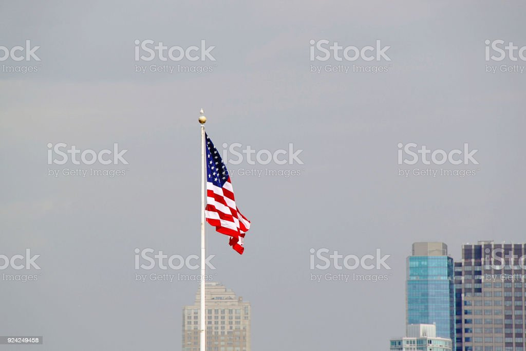 American flag on sky background. stock photo