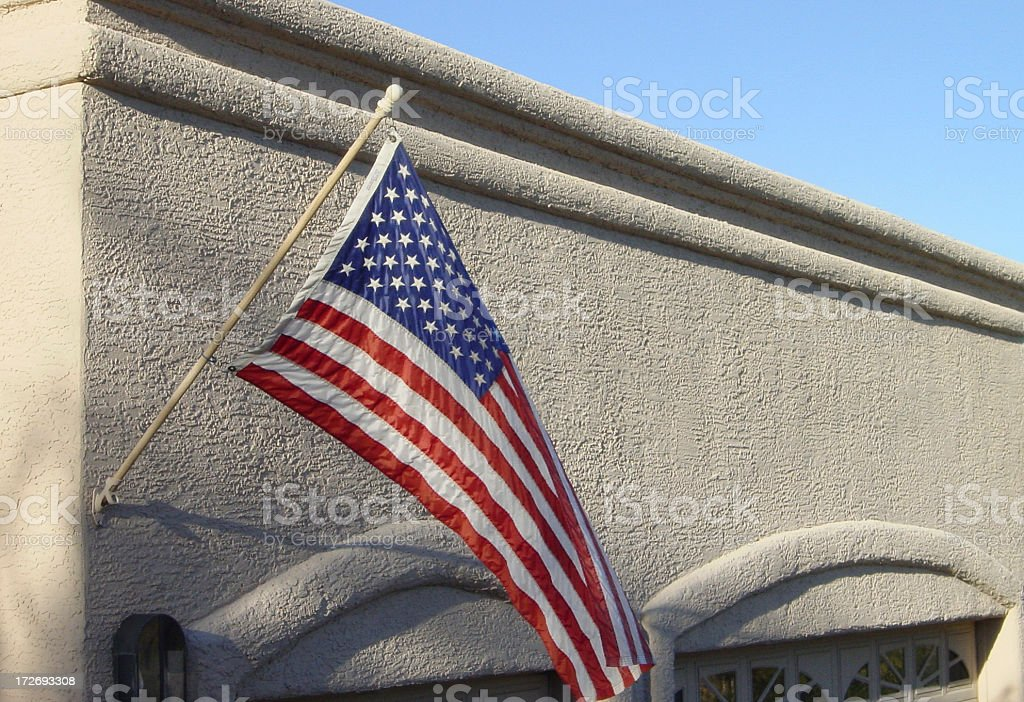 American Flag on Southwest Adobe House royalty-free stock photo