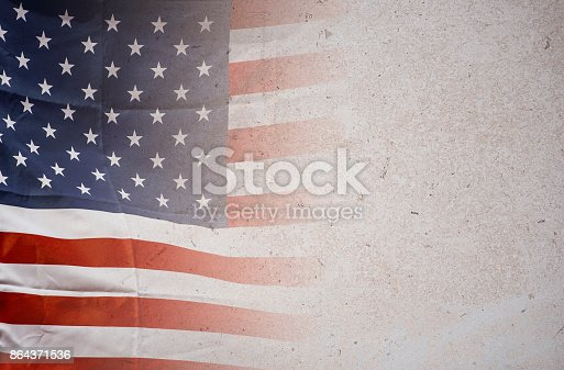 istock American flag on stone background, USA flag 864371536