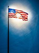 istock American flag on the blue sky 589956324