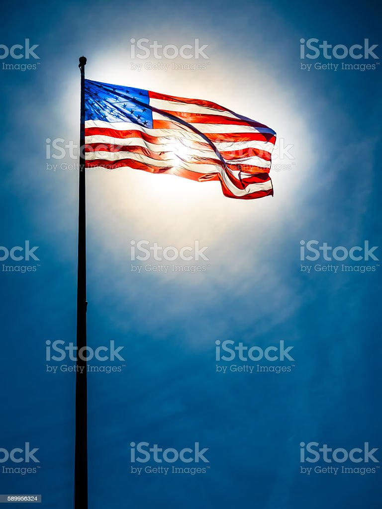 American flag on the blue sky stock photo