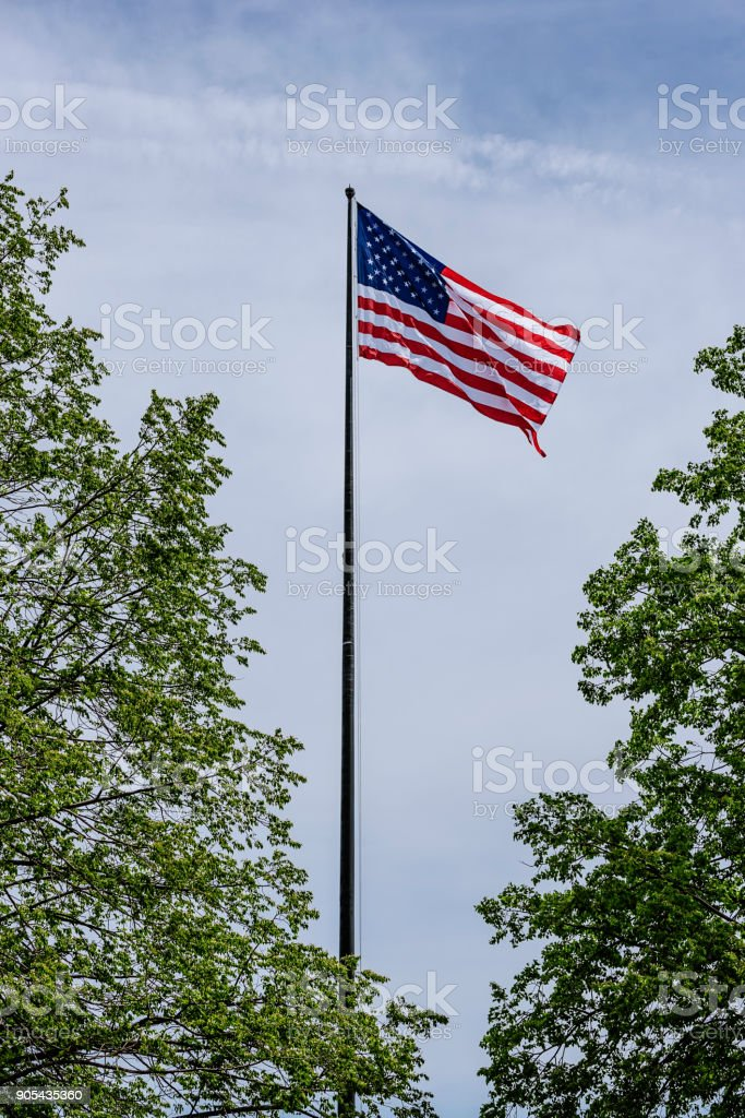 American Flag on the blue sky. stock photo