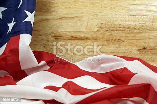 953130996 istock photo American Flag on the wooden table for Memorial Day or 4th of July background 965648734