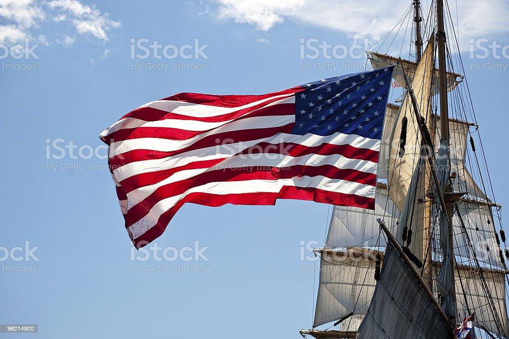 American flag on vintage tall ship. stock photo
