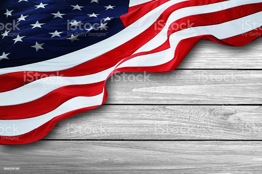 American flag on white wood background stock photo