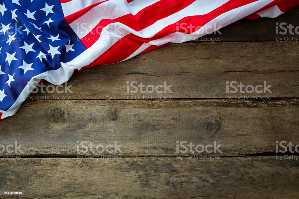 American flag on wood background stock photo