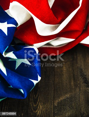612818918 istock photo American flag on wood table for US holidays 597245554
