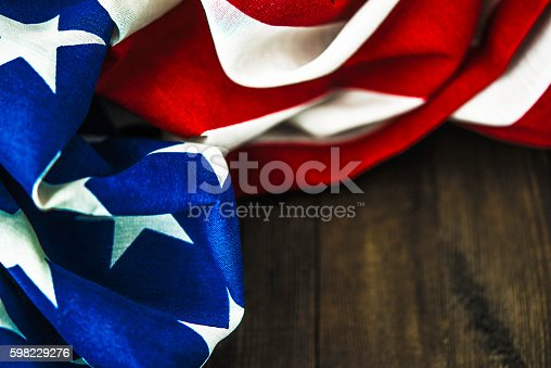 612818918 istock photo American flag on wood table for US holidays 598229276