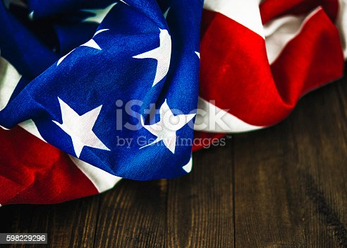612818918 istock photo American flag on wood table for US holidays 598229296