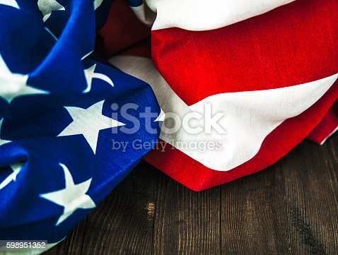 612818918 istock photo American flag on wood table for US holidays 598951352