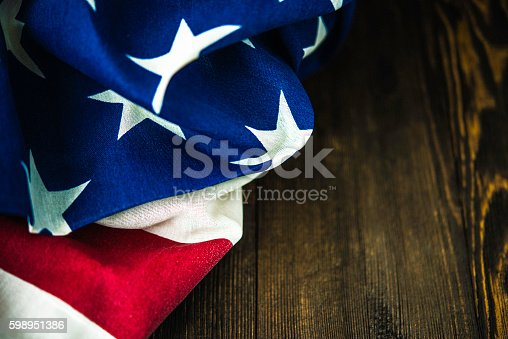612818918 istock photo American flag on wood table for US holidays 598951386