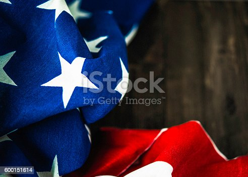 612818918 istock photo American flag on wood table for US holidays 600151614