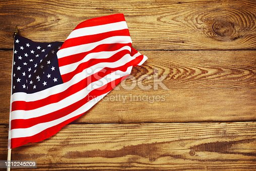 971061452 istock photo American flag on wooden background 1212245209
