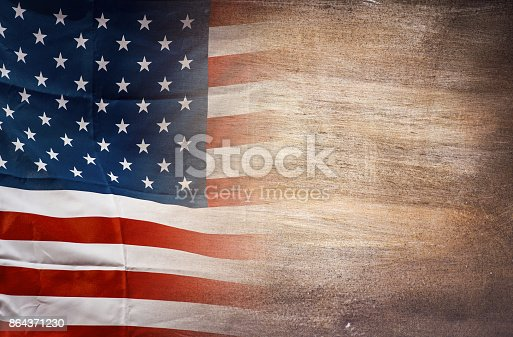 istock American flag on wooden background, USA flag 864371230