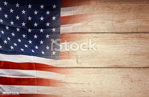 istock American flag on wooden background, USA flag 864371278
