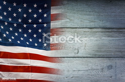 istock American flag on wooden background, USA flag 864371418