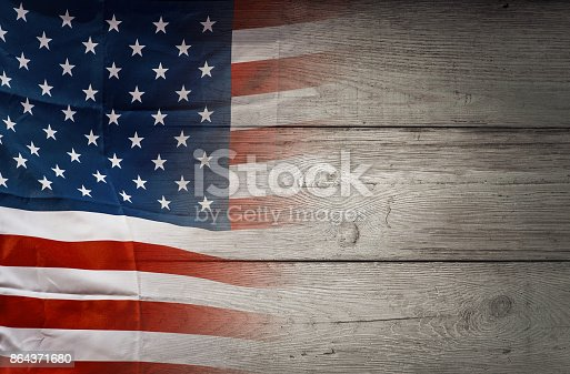 istock American flag on wooden background, USA flag 864371680