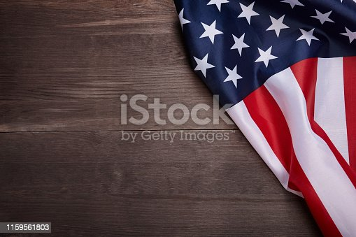 840615050 istock photo American flag on wooden background with copy space. 1159561803