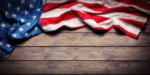 american flag on wooden table - independence day - grunge textures - american flag stock pictures, royalty-free photos & images
