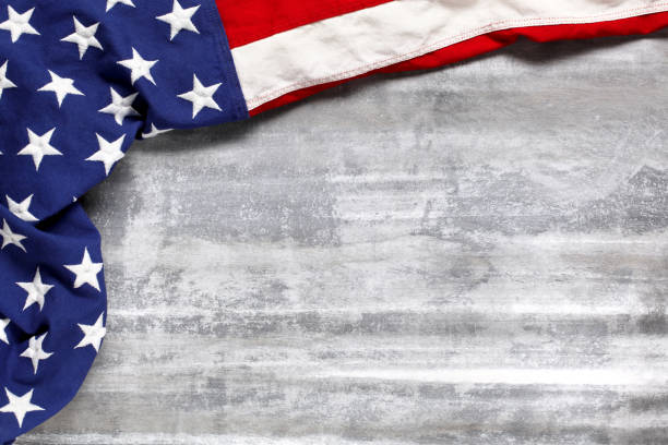 us american flag on worn white wooden background. for usa memorial day, veteran's day, labor day, or 4th of july celebration. with blank space for text. - veterans day zdjęcia i obrazy z banku zdjęć