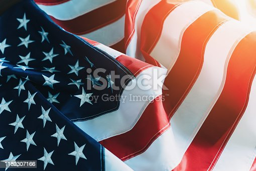 American Flag or United States of America national flag background in sunlight, close up.