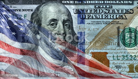 Close up transparent american flag over American one hundred dollar bill