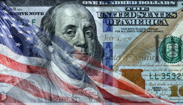American flag over American dollar stock photo