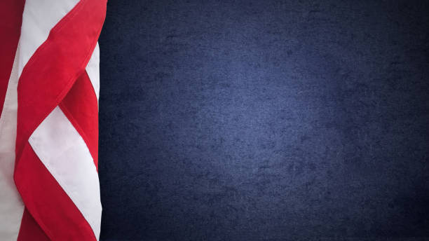 American Flag Over Blue Paper Texture stock photo