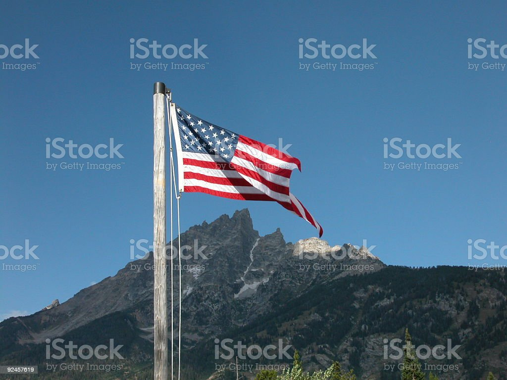 American Flag over Grand Teton stock photo