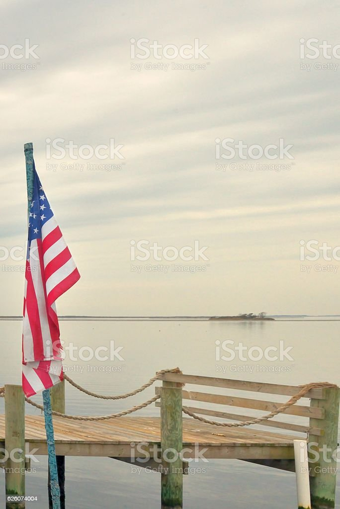 American Flag Over Sinepuxent Bay Island stock photo