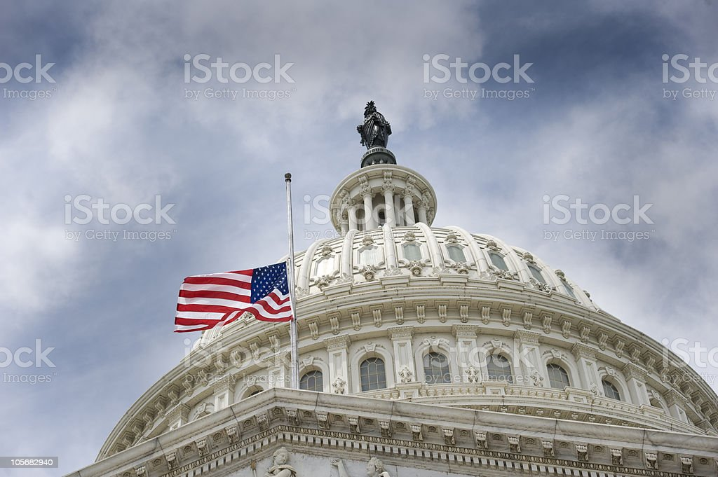 American flag over U.S. Capitol stock photo