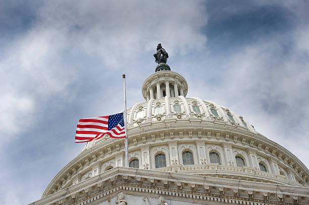 American flag over U.S. Capitol stock photo
