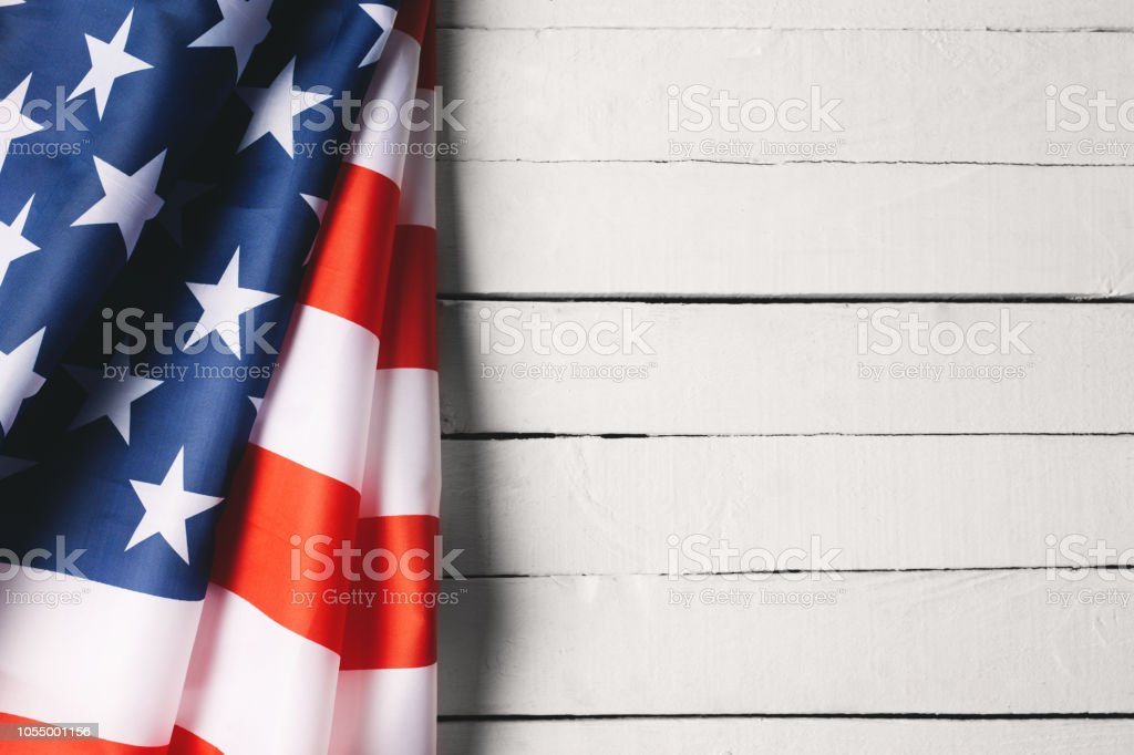 American Flag Over Wood Background stock photo