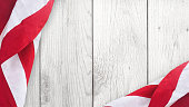 American Flag Over Wood Background