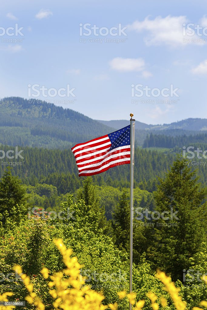 American Flag Overlooking Mountains stock photo