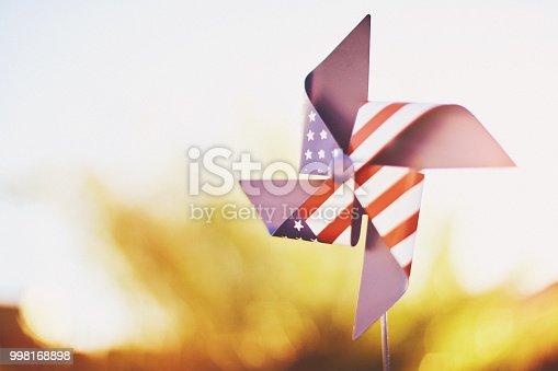 American flag patriotic pinwheel in summer sunshine